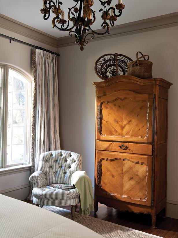 Bedroom Sitting Area With Plaid Armchair and Traditional Wood Armoire