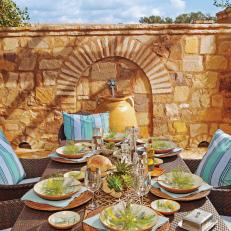 Outdoor Dining Area And Decorative Yellow Stone Wall