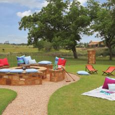 Rustic Outdoor Fire Pit With Stone Benches Cushion Seating
