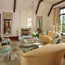 French Country Living Room with Exposed Beam Vaulted Ceilings