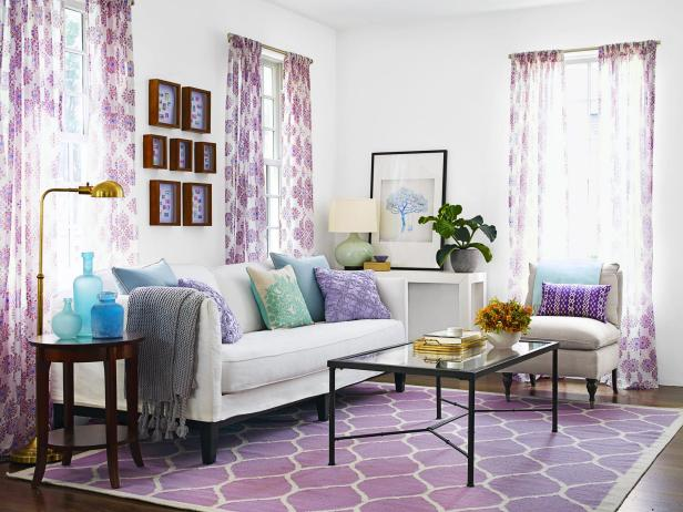 Purple Curtains, Rug and Pillows in a White Living Room
