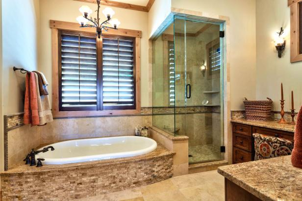 Brown Bathroom With White Tub and Neutral Accents