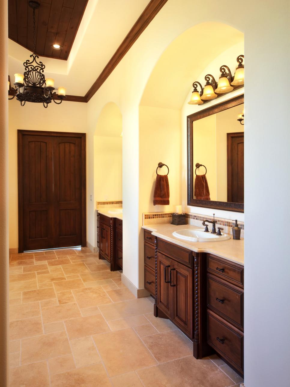 Brown and Cream Master Bathroom With Wood Vanities