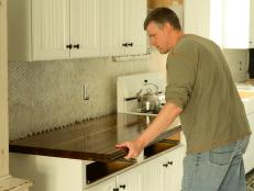 Here's how to remove a slanted countertop, cut a replacement and install it so the counter is nice and level.