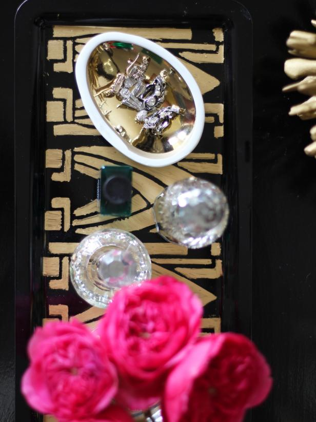 This bird's-eye, partial view of a DIY Art Deco vanity tray, illustrates the level of sophistication and artistry visible in this do-it-yourself design. Objects seem to sparkle as they are placed on the tray.