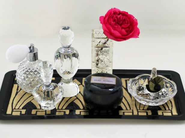 Once your have completed all the steps to create your Art Deco vanity tray, finish by arranging all of your beautiful perfume bottles across its surface. We especially love it styled with glass and crystal containers and a vase of fresh, colorful flowers.