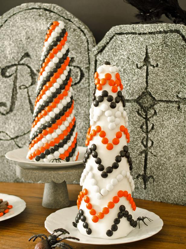 Cover inexpensive foam topiary forms with fondant and candy to create a sweet Halloween decoration or centerpiece that kids will love helping to craft.