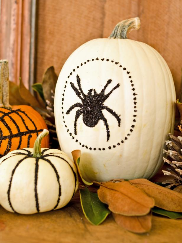 For a fun and easy Halloween crafting project, give plain pumpkins a glamorous makeover using school glue and black glitter.