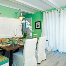 Green Cottage Dining Room with Flowing Drapes