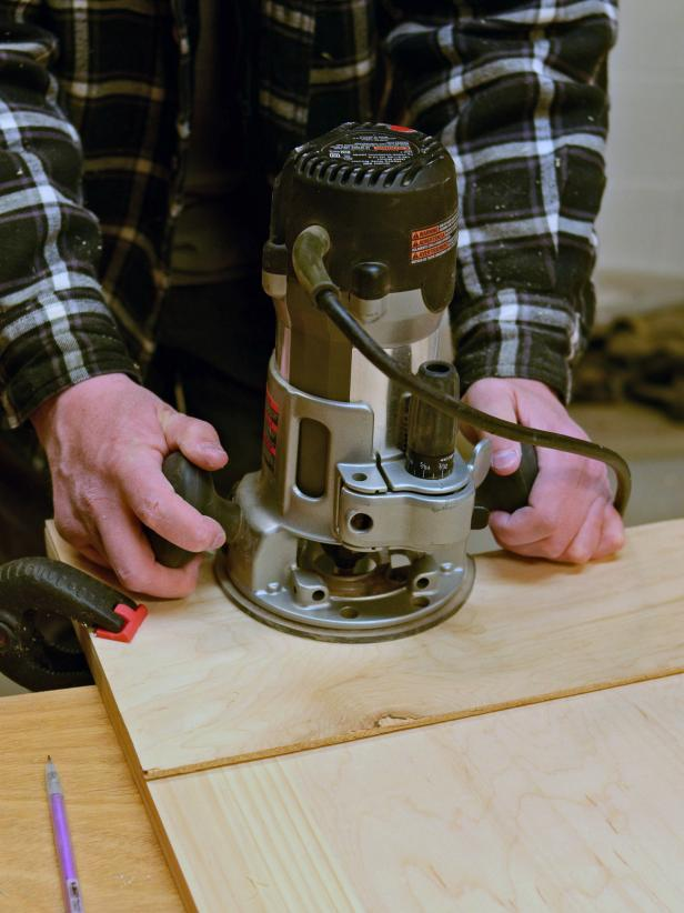 When working on a custom project it's important to sand cut edges smooth. Position template over bottom of front panel and clamp into place with bar clamps. Use router equipped with a shank-side bearing flush-trim bit and let it ride along template to cut arch