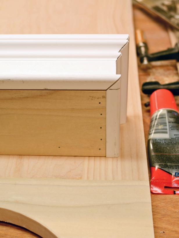 To ensure proper construction when putting together a the shelf for a custom range hood, dry-fit the front and sides to the shelf before nailing the pieces into place.