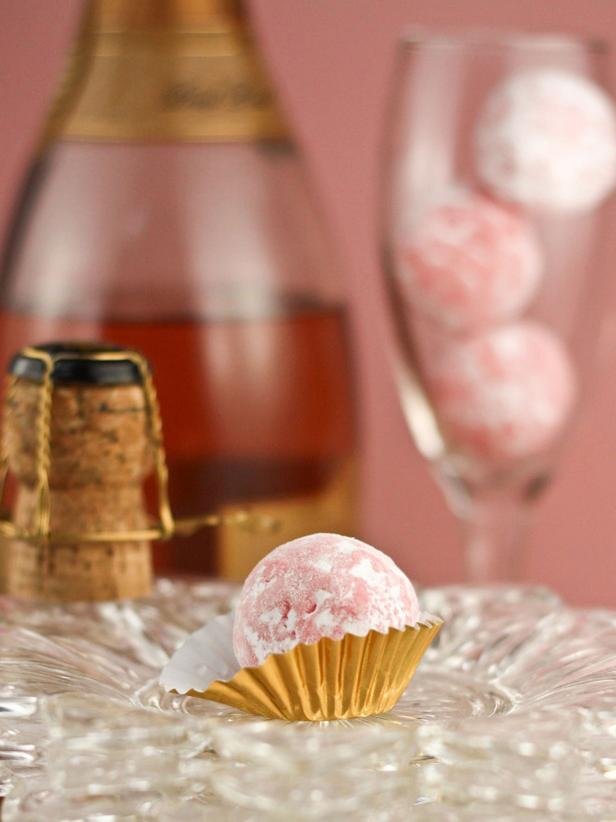 Make your wedding toast even sweeter with pink champagne truffles. Display them in foil candy wrappers for extra eye appeal.