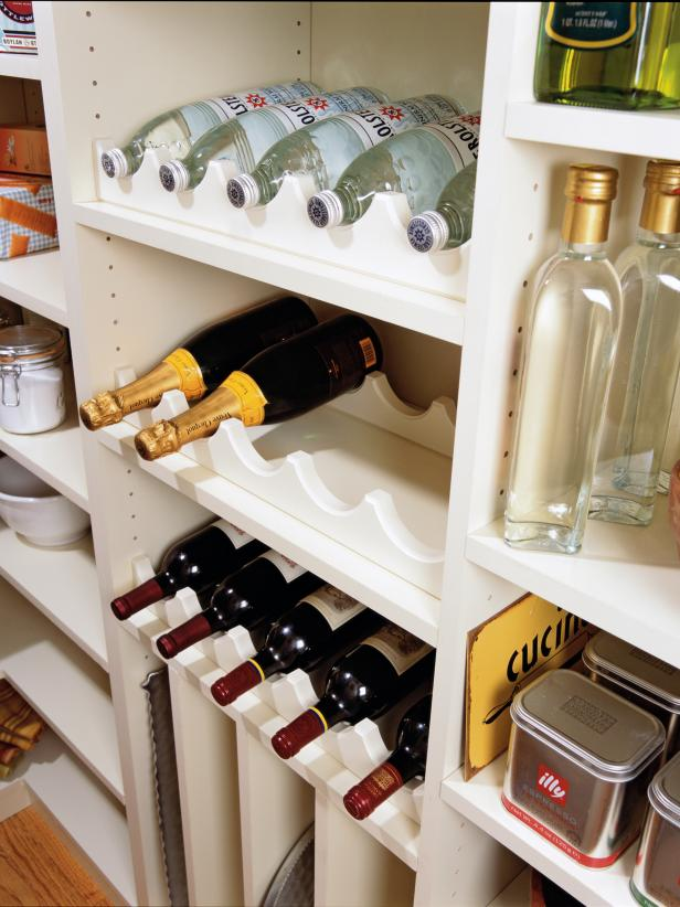 Shelves in pantry for bottle storage