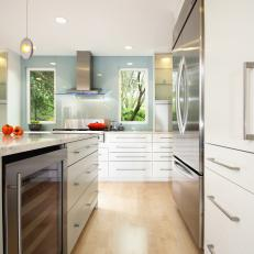 Contemporary White Kitchen With Stainless Steel Accents