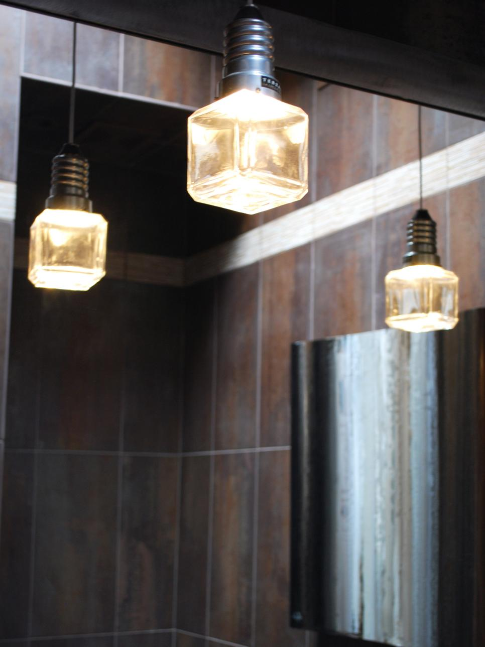 Brown Bathroom With Industrial Cube Pendants Reflecting in Mirror