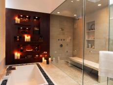 Designer Christopher Grubb created a modern bathroom that features a large walk-in shower, sunken tub and double vanity.