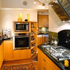 Brown and White Kitchen With Glass Range Hood