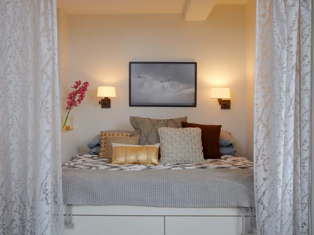 Small Bedroom With White Bed, Gray Patterned Bedding & White Curtains