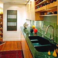 Kitchen With Green Tile Backsplash and Wine Racks