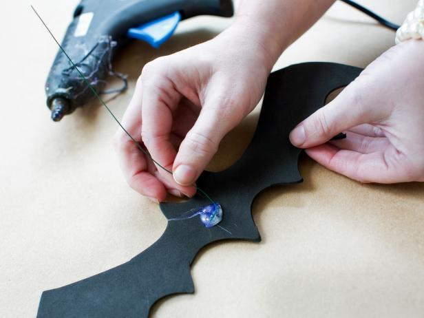 Cut floral wire into 10-inch lengths with scissors, one for each bat. Attach floral wire directly to the back of each foam bat with hot glue.