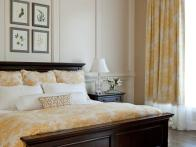 Traditional Yellow Bedroom With Wainscoting