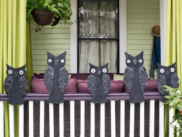 Dress up your banister with DIY owls. Trace owl silhouettes onto pressure-treated plywood, then cut them out with a jigsaw. Sand the surface, then paint each owl, front and back, with flat black paint. Add eyes with two-inch washers fastened with picture nails and staple on leaf-shaped pieces of vinyl fabric to create feathered wings. Attach basic plumbing straps to each owl's back then tighten the straps around the bannister to keep your owls on All Hallow's Eve neighborhood watch.