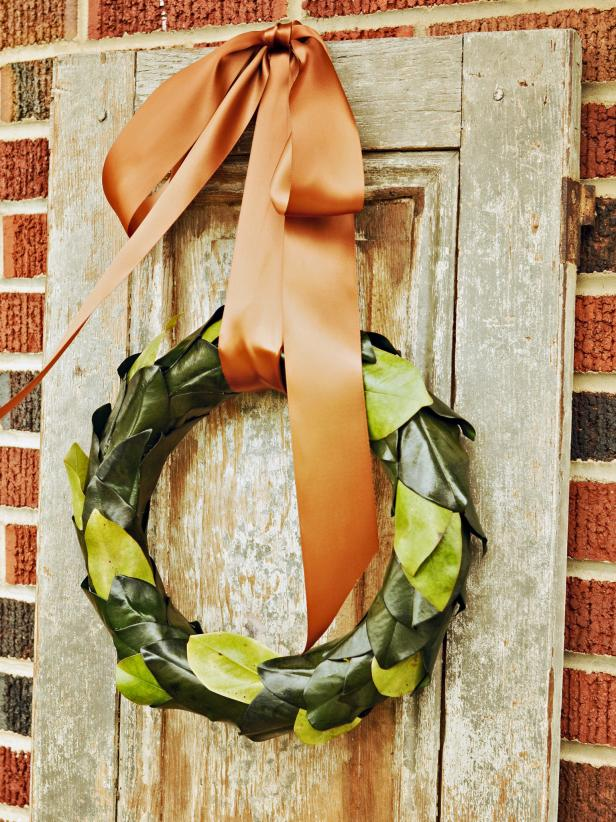 Wreaths don't have to be full and fluffy to be beautiful.  Try making this simple, modern take on the traditional holiday wreath with preserved or freshly cut magnolia leaves.