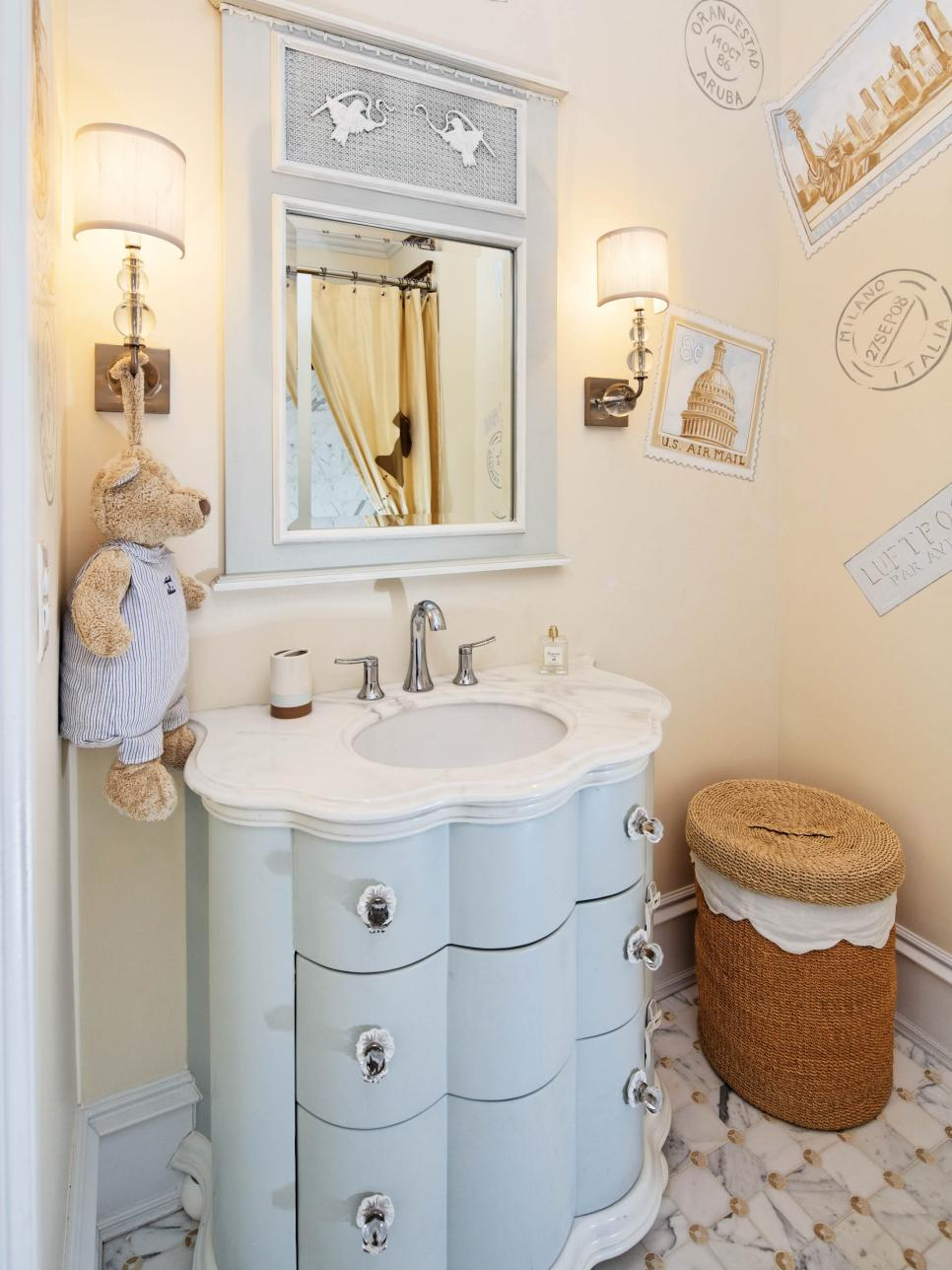 Neutral Bathroom With Blue Vanity, Sconces and Wall Decals