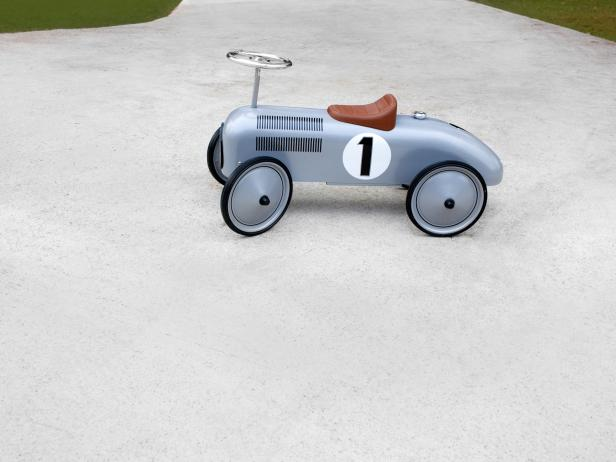 Silver Toy Car in Driveway
