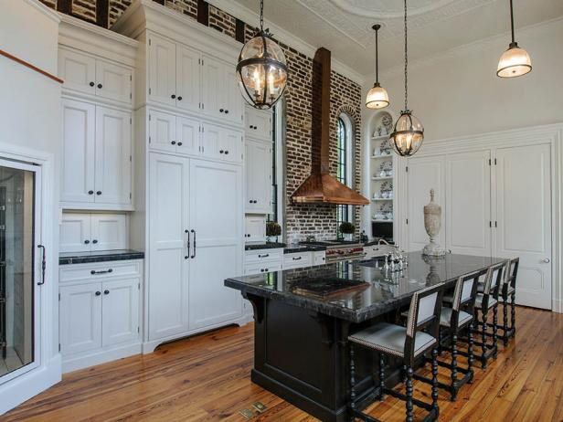 Traditional White Eat-In Kitchen with Brick Wall and Copper Range Hood