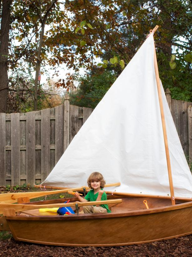 Brown and White Sandbox Sailboat