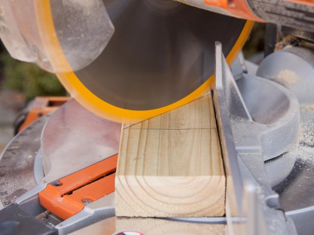 Use chop saw set to 45-degree angle configuration to create proper shape needed for a spike. Repeat 3 times for a total of 4 spikes.