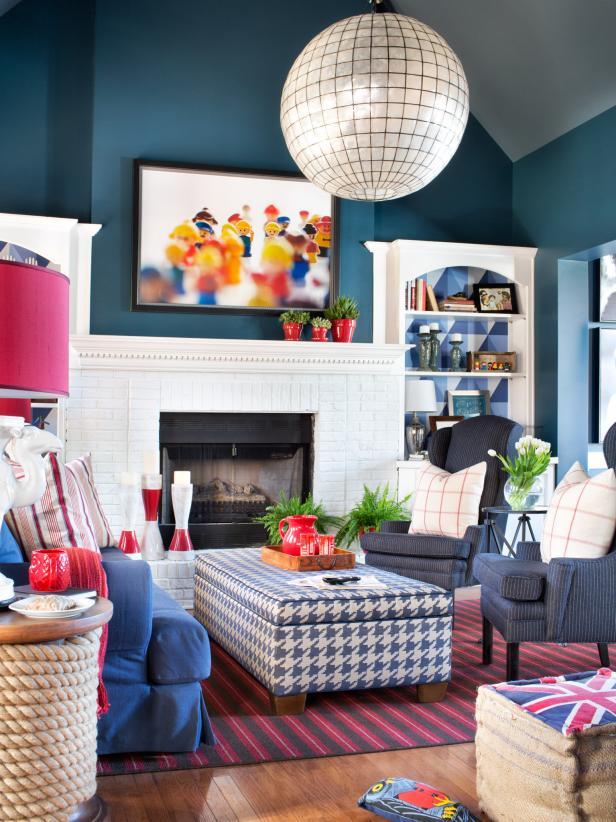Eclectic Red and Blue Living Room With Built-In Shelves