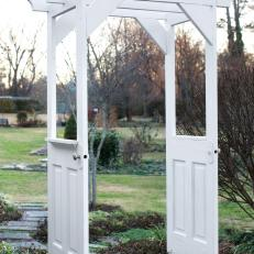 White Arbor Built from Repurposed Doors & Photos | HGTV