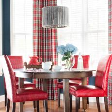 Navy Breakfast Nook With Red Dining Chairs And Plaid Drapes