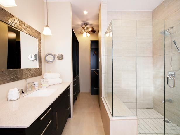 Bathroom With Black Cabinets, White Counters and Spacious Glass Shower
