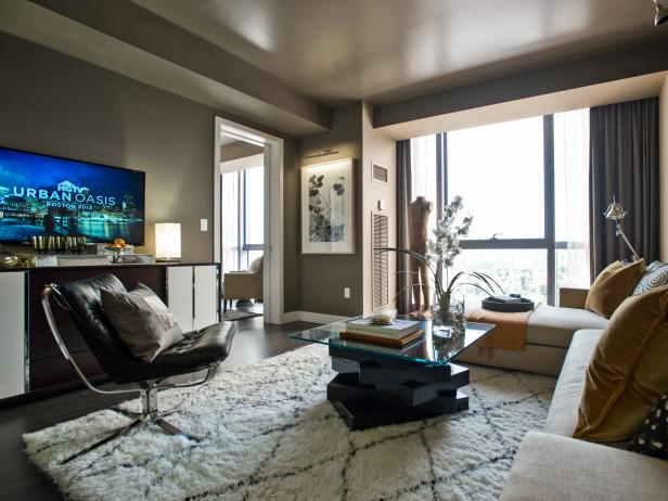 Taupe Living Room With Sectional, Glass Coffee Table and Large Windows