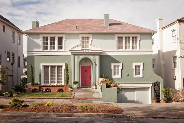 Mint Green Home Exterior With Red Front Door and Pediment Detail