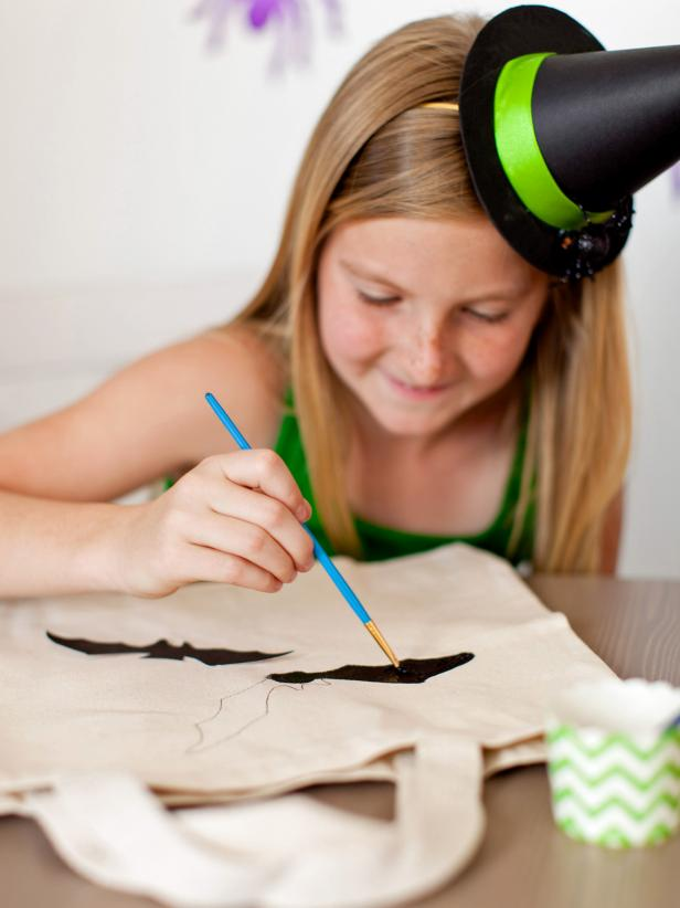 Using a small paintbrush, outline the design then fill it in with water-based craft paint.