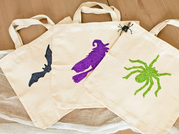 Get kids ready for trick-or-treating with a custom-painted and glittered Halloween tote bag.