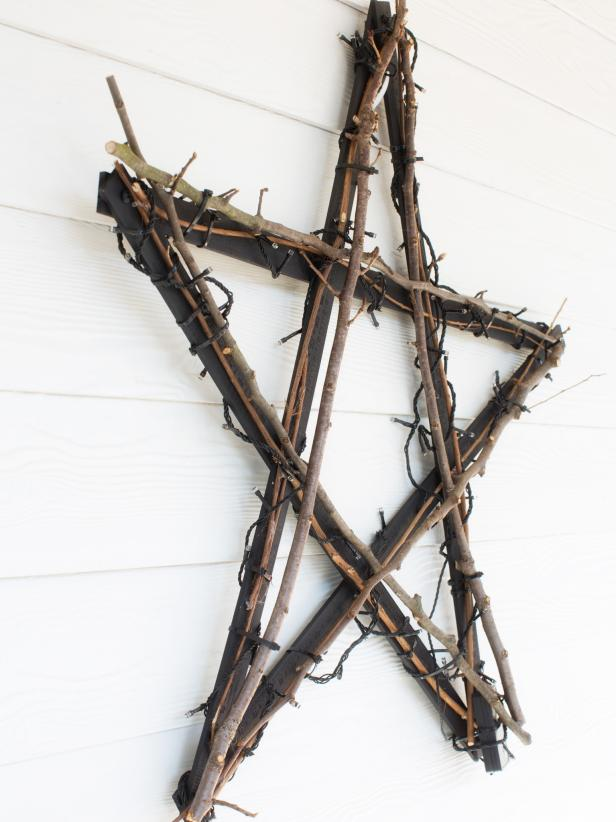 "Rather than searching for a ready-made star with the proper scale and proportion, create a customized wall hanging from wooden yardsticks, spray paint, twinkle lights and twigs. <a target=""blank"" href=""http://www.hgtv.com/handmade/create-a-north-star-wall-hanging-with-yardsticks/index.html"">Get the step-by-step instructions</a>."