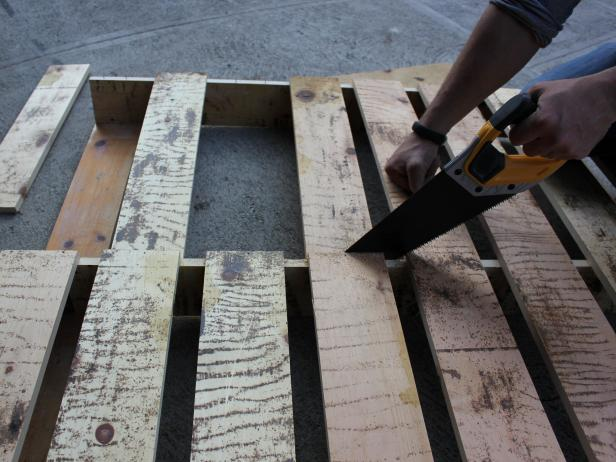 Referring to mark made with pencil or marker, cut top planks to size using saw. Turn over and repeat with bottom planks.