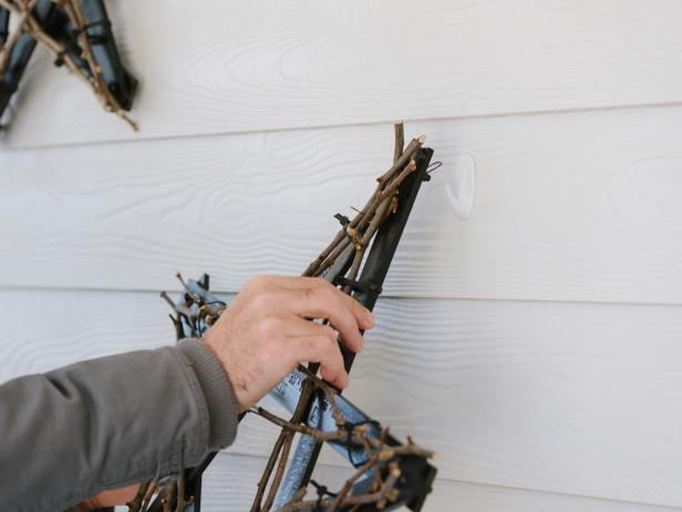 Using a basic picture nail and hammer (or adhesive wall hooks), hang the star to exterior of house.