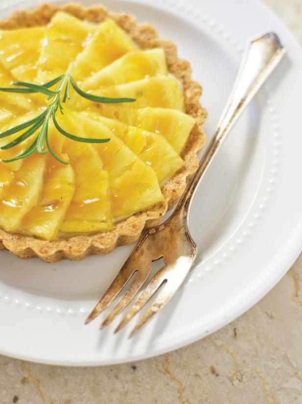 Packed with flavor from pineapple, ginger and rosemary, this tartlet is a refreshing dessert any guest will love. <a href=&quot;http://www.hgtv.com/entertaining/pineapple-tartlette-recipe/index.html>Get the recipe.</a>