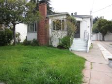 Before: White Home With Neglected Yard