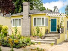 Yellow Cottage Home With Blue Front Door