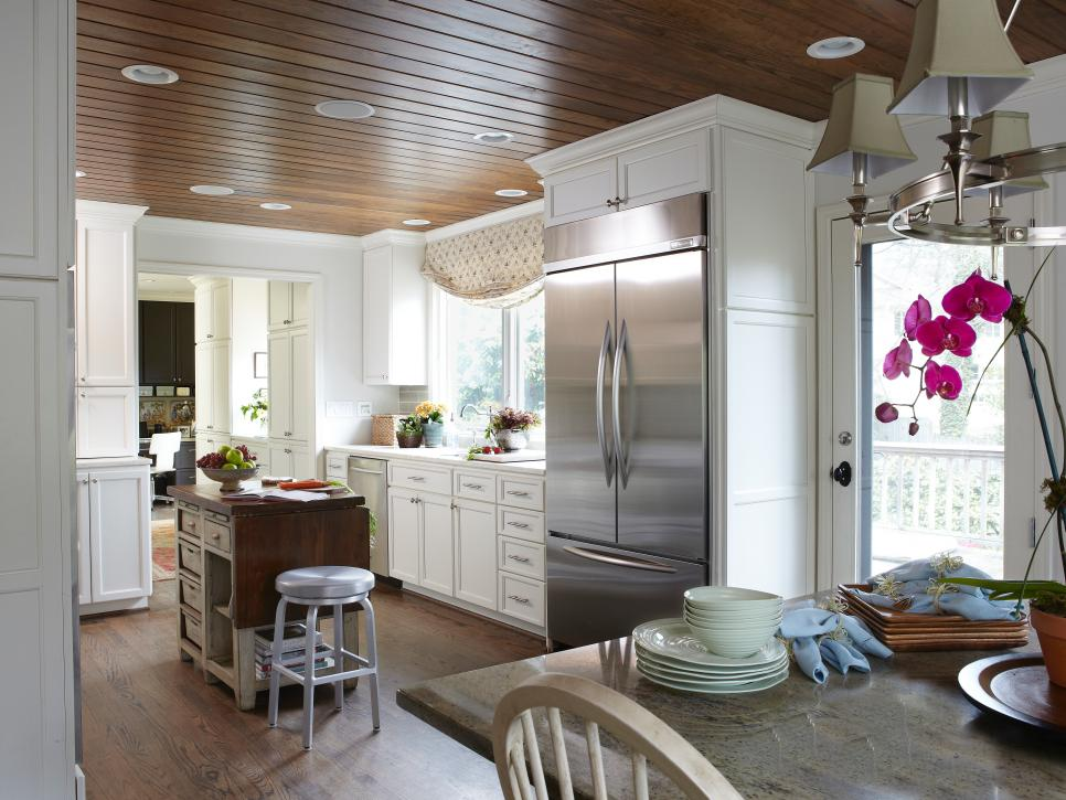 White Gourmet Kitchen With White Cabinets and Wood Floor and Ceiling