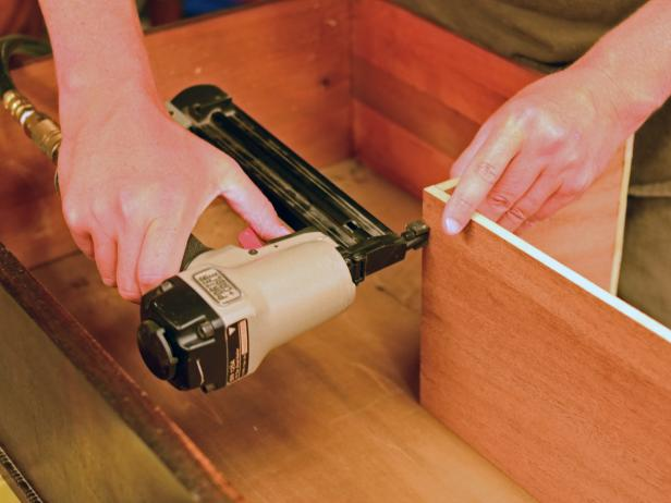Reassembled drawers are nailed in a DIY bathroom vanity.