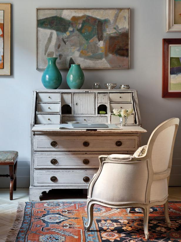 Office Space with Vintage-Inspired Furniture and Colorful Artwork