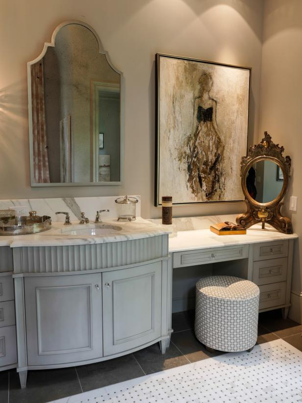 Bathroom With Grey-Blue Vanity and Makeup Space With White Wall Art
